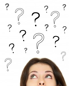 Woman looking up on question marks above head isolated on white