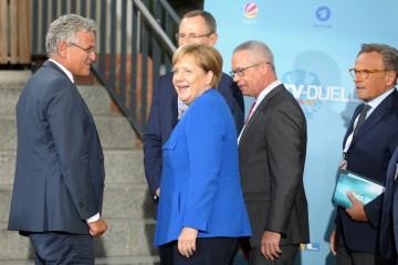今回は青いジャケットで登場。アンゲラ・メルケル首相 (CDU党首)©dpa
