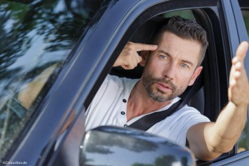 picture of an angry male driver making gesture